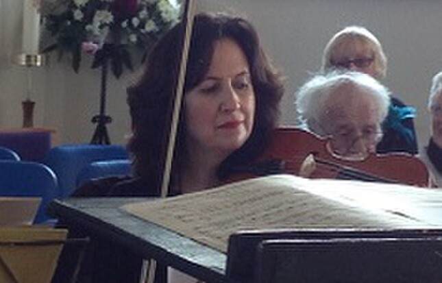 Jane Cordell playing viola with the Ramsbottom orchestra.